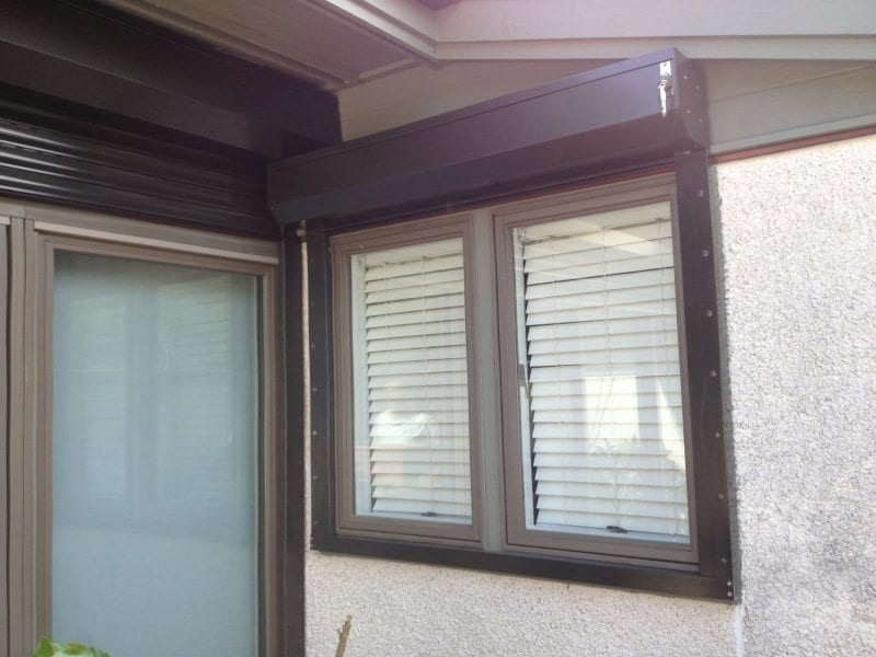 Rolldown Shutters for Hurricane Protection on the porch of a Waterfront Home Near Wilmington Being Installed