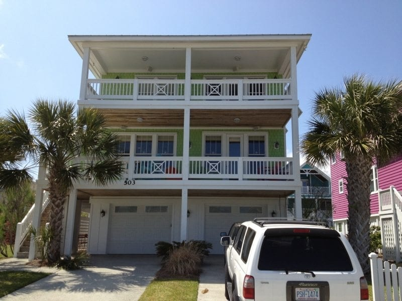 Panel Shutters for Hurricane Protection on the Front of a Yellow House Near Carolina Beach